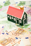 Miniature house on euro banknotes field Stock Image