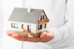 Miniature house on hand Royalty Free Stock Photography