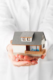 Miniature house in hands Stock Photography