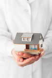 Miniature house in hands Stock Image