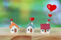 Miniature house with heart sign and blur light bokeh ,love family. Concept royalty free stock images