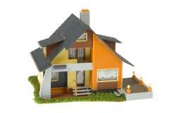 Miniature  house isolated on white background Stock Photos