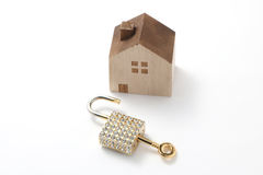 Miniature house and key isolated on white background Royalty Free Stock Photos