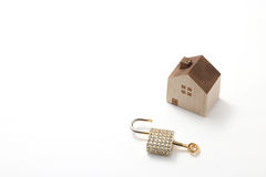 Miniature house and key isolated on white background Stock Image