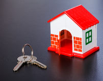 Miniature house and keys Royalty Free Stock Photos