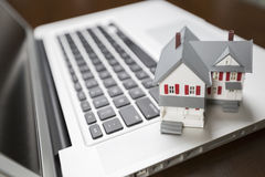 Miniature House on Laptop Computer Stock Photos