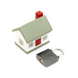 Miniature house with lock Royalty Free Stock Images