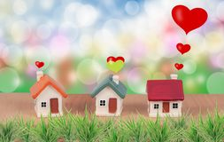 Miniature house with love sign on plant. Frame stock photos