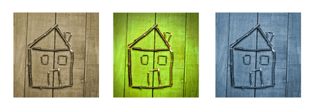 Miniature of house made from sticks on wooden background. Triptych in brown, green and blue. Stock Image