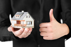 Miniature House in man's hand. Royalty Free Stock Photo