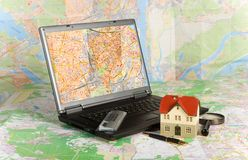 Miniature house on map. Part of Series. See Portfolio For Similar Images royalty free stock image