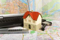 Miniature house on map Royalty Free Stock Photo