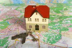 Miniature house on map. Part of Series. See Portfolio For Similar Images stock photos