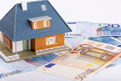 Miniature house model on euro money banknotes. Real estate industry concept Stock Photo