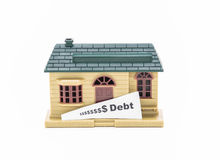 miniature house model with warning white message tag on white background Stock Photos