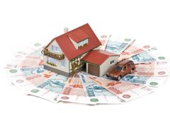 Miniature House and Money. stock image
