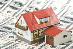 Miniature House and Money. Stock Photos
