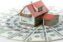 Miniature House and Money. Buying house concept stock image