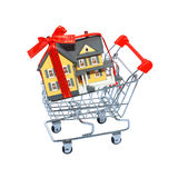Miniature house in shopping cart isolated Stock Photos