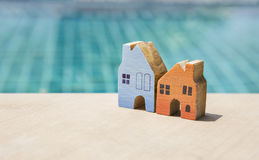 Miniature house with space on swimming pool background Royalty Free Stock Photo