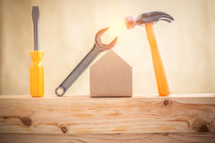 Miniature house and tools Stock Images