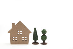 Miniature house and trees on white background. Stock Photos