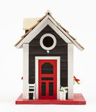 Miniature house on a white stock photography