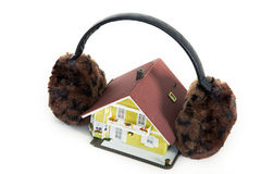 Miniature house with winter ears Royalty Free Stock Image
