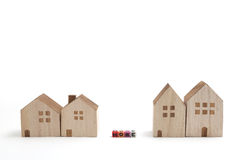 Miniature houses with alphabet blocks that spell home. Royalty Free Stock Image