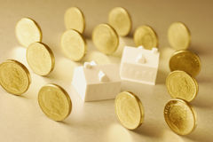 Miniature Houses and Coins Stock Photos