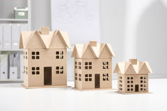Miniature houses on the desk in office Stock Photography