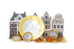 Miniature houses and euro coins Royalty Free Stock Image