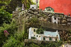 Miniature houses on the rocks Royalty Free Stock Photography