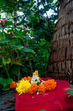 Small statue of Lord Ganesha among plants. Ganpati festival. royalty free stock photo
