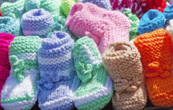 A miniature knitted shoes for kids Stock Photo