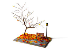miniature lantern and bench in autumn park made from plasticine Stock Photos