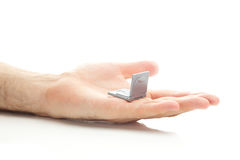 Miniature laptop in hand Royalty Free Stock Image