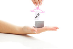 Miniature laptop and hanger with a sale in hand Stock Photography