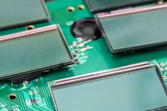 Miniature LCD panels on the motherboard. Circuit Board close-up. Detail of an electronic printed circuit board with mounted display screen Royalty Free Stock Photography