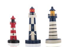 Miniature lighthouses. Isolated over white background stock photo