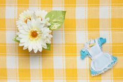 Miniature maid outfit and flowers Stock Photo