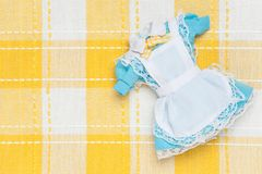Miniature maid outfit Royalty Free Stock Images