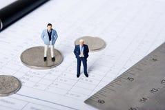 Miniature man with key Stock Photos