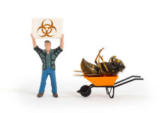 Miniature man with a sign - dead wasp Royalty Free Stock Photo