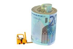 A miniature man sitting in a yellow forklift truck lifting a rol Stock Photo