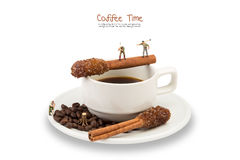Miniature man work on coffee cup with Sugar Stick Cinnamon Royalty Free Stock Image