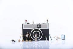 Miniature men working Stock Photography