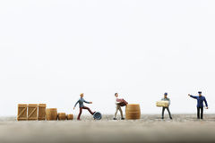 Miniature men working Stock Photo