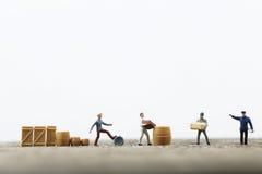 Miniature men working Stock Photo