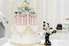 Miniature Mickey and Minnie. Miniature marzipan Mickey and Minnie near wedding cake. Wedding fair in Brasov Business Park 2014 royalty free stock images